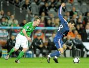 14 November 2009; Yoann Gourcuff, France, in action against Glenn Whelan, Republic of Ireland. FIFA 2010 World Cup Qualifying Play-off 1st Leg, Republic of Ireland v France, Croke Park, Dublin. Picture credit: Stephen McCarthy / SPORTSFILE