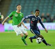 14 November 2009; Patrice Evra, France, in action against Robbie Keane, Republic of Ireland. FIFA 2010 World Cup Qualifying Play-off 1st Leg, Republic of Ireland v France, Croke Park, Dublin. Picture credit: Stephen McCarthy / SPORTSFILE
