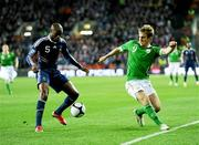 14 November 2009; William Gallas, France, in action against Kevin Doyle, Republic of Ireland. FIFA 2010 World Cup Qualifying Play-off 1st Leg, Republic of Ireland v France, Croke Park, Dublin. Picture credit: Stephen McCarthy / SPORTSFILE