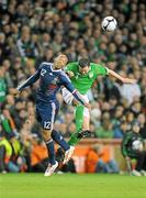 14 November 2009; Thierry Henry, France, in action against John O'Shea, Republic of Ireland. FIFA 2010 World Cup Qualifying Play-off 1st Leg, Republic of Ireland v France, Croke Park, Dublin. Picture credit: Stephen McCarthy / SPORTSFILE