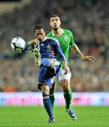 14 November 2009; Patrice Evra, France, in action against Leon Best, Republic of Ireland. FIFA 2010 World Cup Qualifying Play-off 1st Leg, Republic of Ireland v France, Croke Park, Dublin. Picture credit: David Maher / SPORTSFILE