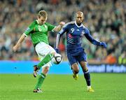 14 November 2009; Glenn Whelan, Republic of Ireland, in action against Nicolas Anelka, France. FIFA 2010 World Cup Qualifying Play-off 1st Leg, Republic of Ireland v France, Croke Park, Dublin. Picture credit: David Maher / SPORTSFILE