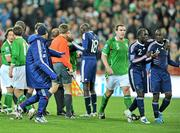 14 November 2009; Richard Dunne, Republic of Ireland, with Bakary Sagna, no. 2 and Lassana Diarra, no. 6, France, at the end of the game. FIFA 2010 World Cup Qualifying Play-off 1st Leg, Republic of Ireland v France, Croke Park, Dublin. Picture credit: David Maher / SPORTSFILE