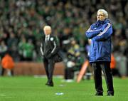 14 November 2009; France manager Raymond Domenech, looks on during the game with Republic of Ireland manager Giovanni Trapattoni, behind. FIFA 2010 World Cup Qualifying Play-off 1st Leg, Republic of Ireland v France, Croke Park, Dublin. Picture credit: David Maher / SPORTSFILE