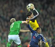 14 November 2009; Hugo Lloris and Patrice Evra, no.13, France, in action against Liam Lawrence, Republic of Ireland. FIFA 2010 World Cup Qualifying Play-off 1st Leg, Republic of Ireland v France, Croke Park, Dublin. Picture credit: David Maher / SPORTSFILE