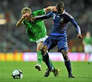 14 November 2009; Liam Lawrence, Republic of Ireland, in action against Eirc Abidal, France. FIFA 2010 World Cup Qualifying Play-off 1st Leg, Republic of Ireland v France, Croke Park, Dublin. Picture credit: David Maher / SPORTSFILE