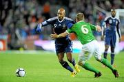 14 November 2009; Nicolas Anelka, France, in action against Glenn Whelan, Republic of Ireland. FIFA 2010 World Cup Qualifying Play-off 1st Leg, Republic of Ireland v France, Croke Park, Dublin. Picture credit: Matt Browne / SPORTSFILE