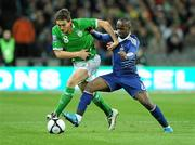 14 November 2009; Keith Andrews, Republic of Ireland, in action against Lassana Diarra, France. FIFA 2010 World Cup Qualifying Play-off 1st Leg, Republic of Ireland v France, Croke Park, Dublin. Picture credit: Paul Mohan / SPORTSFILE