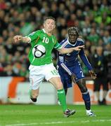 14 November 2009; Robbie Keane, Republic of Ireland, in action against Bacary Sagna, France. FIFA 2010 World Cup Qualifying Play-off 1st Leg, Republic of Ireland v France, Croke Park, Dublin. Picture credit: Paul Mohan / SPORTSFILE