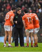 31 January 2016; Armagh manager Kieran McGeeney speaking to his players including Stefan Campbell, 10, Miceal McKenna, 11, and Mark Shields as they await the arrival of the Meath players after the half time break. Allianz League, Division 2, Round 1, Meath v Armagh, Páirc Tailteann, Navan, Co. Meath. Picture credit: Ray McManus / SPORTSFILE