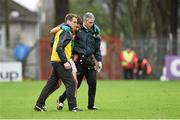 31 January 2016; Lee Keegan, Mayo, is assisted off the pitch by selector Tony McEntee, left, and Dr Sean Moffatt after picking up an injury. Allianz Football League, Division 1, Round 1, Cork v Mayo. Páirc Ui Rinn, Cork. Picture credit: Diarmuid Greene / SPORTSFILE