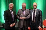 30 January 2016; Máistir na gCeist Séamus Curley is presented with an award by Antóin Mac Gabhann, Cathaoirleach Coiste Naisiúnta Scór, left, and Uachtarán Chumann Lúthchleas Gael Aogán Ó Fearghail. Scór na nÓg. INEC, Gleneagle Hotel, Killarney, Co. Kerry. Picture credit: Piaras Ó Mídheach / SPORTSFILE