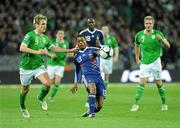 14 November 2009; Patrice Evra, France, in action against Kevin Doyle, Republic of Ireland. FIFA 2010 World Cup Qualifying Play-off 1st Leg, Republic of Ireland v France, Croke Park, Dublin. Picture credit: Paul Mohan / SPORTSFILE