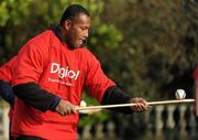 """18 November 2009; Fijian captain Seremaia Bai tries his hand at hurling during a visit to the team camp in Dublin by Fijian-born Cork hurling star, Seán Óg Ó hAilpín. The rugby players were treated to a hurling skills session with one of the biggest names in Gaelic games, courtesy of Digicel who are sponsoring the Fijians' trip to Ireland. Speaking after today's coaching session, Ó hAilpín said: """"Today was a great opportunity for me to show visitors to Ireland what Gaelic games are all about. I was born in Fiji and lived there until I was three, so I'm delighted that Digicel was able to organize this coaching session."""" The Fijians play Ireland in the RDS on Saturday, November 21st, in the RDS. Kick off is at 17.15. A limited number of tickets are still available from the Spar shop in Donnybrook. Radisson Blu St Helens Hotel, Stillorgan Road, Dublin. Picture credit: Brendan Moran / SPORTSFILE"""