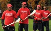 """18 November 2009; Fijian players, Vereniki Sauturaga, left, Asaeli Boko, centre, and Aisake Tarogi get to grips with a hurley during a visit to the team camp in Dublin by Fijian-born Cork hurling star, Seán Óg Ó hAilpín. The rugby players were treated to a hurling skills session with one of the biggest names in Gaelic games, courtesy of Digicel who are sponsoring the Fijians' trip to Ireland. Speaking after today's coaching session, Ó hAilpín said: """"Today was a great opportunity for me to show visitors to Ireland what Gaelic games are all about. I was born in Fiji and lived there until I was three, so I'm delighted that Digicel was able to organize this coaching session."""" The Fijians play Ireland in the RDS on Saturday, November 21st, in the RDS. Kick off is at 17.15. A limited number of tickets are still available from the Spar shop in Donnybrook. Radisson Blu St Helens Hotel, Stillorgan Road, Dublin. Picture credit: Brendan Moran / SPORTSFILE"""
