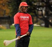 """18 November 2009; Fijian winger Nasoni Roko tries his hand at hurling during a visit to the team camp in Dublin by Fijian-born Cork hurling star, Seán Óg Ó hAilpín. The rugby players were treated to a hurling skills session with one of the biggest names in Gaelic games, courtesy of Digicel who are sponsoring the Fijians' trip to Ireland. Speaking after today's coaching session, Ó hAilpín said: """"Today was a great opportunity for me to show visitors to Ireland what Gaelic games are all about. I was born in Fiji and lived there until I was three, so I'm delighted that Digicel was able to organize this coaching session."""" The Fijians play Ireland in the RDS on Saturday, November 21st, in the RDS. Kick off is at 17.15. A limited number of tickets are still available from the Spar shop in Donnybrook. Radisson Blu St Helens Hotel, Stillorgan Road, Dublin. Picture credit: Brendan Moran / SPORTSFILE"""