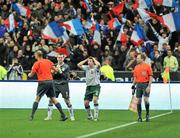 18 November 2009; Republic of Ireland goalkeeper Shay Given and team-mate Sean St. Ledger remonstrate with referee Martin Hansson after William Gallas scored France's goal following Thierry Henry's handballs. FIFA 2010 World Cup Qualifying Play-off 2nd Leg, Republic of Ireland v France, Stade de France, Saint-Denis, Paris, France. Picture credit: David Maher / SPORTSFILE *** Local Caption ***
