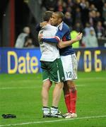 18 November 2009; Thierry Henry, France, and Richard Dunne, Republic of Ireland, embrace following the final whistle. FIFA 2010 World Cup Qualifying Play-off 2nd Leg, Republic of Ireland v France, Stade de France, Saint-Denis, Paris, France. Picture credit: Stephen McCarthy / SPORTSFILE