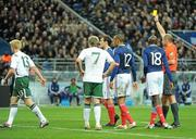 18 November 2009; Referee Martin Hansson shows a yellow card to Paul McShane, Republic of Ireland, 13. FIFA 2010 World Cup Qualifying Play-off 2nd Leg, Republic of Ireland v France, Stade de France, Saint-Denis, Paris, France. Picture credit: Stephen McCarthy / SPORTSFILE