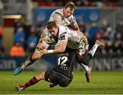 5 February 2016; Craig Gilroy, Ulster, supported by Roger Wilson, is tackled by Adam Warren, Newport Gwent Dragon. Guinness PRO12, Round 12, Refixture, Ulster v Newport Gwent Dragons, Kingspan Stadium, Ravenhill Park, Belfast, Co. Antrim. Picture credit: Oliver McVeigh / SPORTSFILE