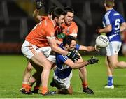 6 February 2016; Gareth Dillon, Laois, in action against Stefan Forker and Gavin McParland. Armagh. Allianz Football League, Division 2, Round 2, Armagh v Laois. Athletic Grounds, Armagh. Picture credit: Oliver McVeigh / SPORTSFILE