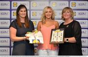 1 June 2016; Áine Tubridy, Antrim, receives her Division 4 Lidl Ladies Team of the League Award from Aoife Clarke, head of communications, Lidl Ireland, left, and Marie Hickey, President of Ladies Gaelic Football, right, at the Lidl Ladies Teams of the League Award Night. The Lidl Teams of the League were presented at Croke Park with 60 players recognised for their performances throughout the 2016 Lidl National Football League Campaign. The 4 teams were selected by opposition managers who selected the best players in their position with the players receiving the most votes being selected in their position. Croke Park, Dublin. Photo by Cody Glenn/Sportsfile