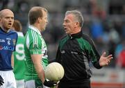 29 November 2009; Referee Pat McEnaney speaks to with Johnny McBride, Loup, during the game. AIB GAA Football Ulster Club Senior Championship Final, St. Gall's v Loup, Páirc Esler, Newry, Co. Down. Picture credit: Oliver McVeigh / SPORTSFILE