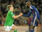 14 November 2009; William Gallas, France, helps Kevin Doyle, Republic of Ireland, to his feet. FIFA 2010 World Cup Qualifying Play-off 1st Leg, Republic of Ireland v France, Croke Park, Dublin. Picture credit: Stephen McCarthy / SPORTSFILE