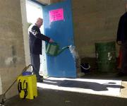 """31 March 2001; """"Kinger"""" Pat King, a member of the ground staff at Semple Stadium, sprays disinfectant on to a matt at an entrance in an effort to stop the spread of Foot and Mouth Disease before the AIB All-Ireland Senior Club Hurling Championship Semi-Final Replay match between Graigue Ballycallan and Sixmilebridge at Semple Stadium in Thurles, Tipperary. Photo by Ray McManus/Sportsfile"""