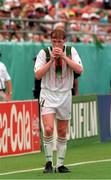 28 June 1994; Steve Staunton, Republic of Ireland, drinks from a water bag during the World Cup, Soccer. Picture credit; David Maher/SPORTSFILE