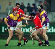 1 April 2001; Pat Mulcahy, Cork in action against Sean Flood, left and Darren Stamp, Wexford . Wexford v Cork, National Hurling League, Belfield, Enniscorthy, Co. Wexford. Picture credit; Aoife Rice / SPORTSFILE
