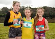 11 February 2016; Second place Ellen Lynch, left, Colaiste na Trocaire Rathkeale, first place Grainne Egan, centre, St Marys Mallow, and third place Meghan Carr, right, Loreto Fermoy, hold their medals following the Minor Girls event. GloHealth Munster Schools Cross Country, Tramore Valley Park, Cork City. Picture credit: Seb Daly / SPORTSFILE