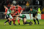 26 December 2009; Jean de Villiers, Munster, is tackled by Kieran Campbell, left, and Andrew Browne, Connacht. Celtic League, Munster v Connacht, Thomond Park, Limerick. Picture credit: Ray McManus / SPORTSFILE