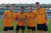 15 February 2016; DCU's, from left, Brian Reape, Shehroz Akram, Michael Plunkett and Matthew Ruane celebrate with the Daithí Billings Cup at the end of the game. Fresher 'A' Football Championship Final. University College Dublin v Dublin City University. Croke Park, Dublin. Picture credit: Piaras Ó Mídheach / SPORTSFILE