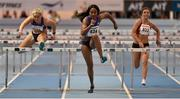 17 February 2016; Sharika Nelvis, USA, centre, on her way to winning the heat 1 of the 60m women's hurdles event ahead of Sarah Lavin, Ireland, left, and Lilly-Ann O'Hora, Ireland, right, at the AIT International Athletics Grand Prix. AIT International Arena, Athlone, Co. Westmeath. Picture credit: Cody Glenn / SPORTSFILE
