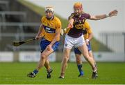 21 February 2016; Conor McGrath, Clare, in action against Andrew Shore, Wexford. Allianz Hurling League, Division 1B, Round 2, Wexford v Clare. Innovate Wexford Park, Wexford. Picture credit: Piaras Ó Mídheach / SPORTSFILE