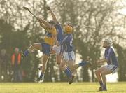 17 January 2010; Paddy Vaughan, Clare, in action against Mark Molloy and Barry Johnston, right, WIT. Waterford Crystal Cup, Clare v WIT, Meelick, Co. Clare. Picture credit: Diarmuid Greene / SPORTSFILE