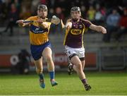 21 February 2016; John Conlan, Clare, in action against Andrew Kenny, Wexford. Allianz Hurling League, Division 1B, Round 2, Wexford v Clare. Innovate Wexford Park, Wexford. Picture credit: Piaras Ó Mídheach / SPORTSFILE