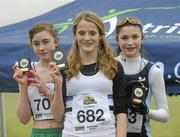 23 January 2010; Lindra Conroy, Mullingar Harriers AC, third place, left, Rachel Dunn, Edinburgh AC, winner, centre, and Yasmin Wilson, City of Lisburn AC, second place, celebrate with their plaques after the Under 15 Girls Race. Antrim IAAF International Cross Country. Greenmount Campus, Belfast, Co. Antrim. Picture credit: Oliver McVeigh / SPORTSFILE