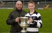 27 February 2016; St Kieran's hurler Seán Carey with his father, former Kilkenny hurler DJ Carey, with the cup after the game. Top Oil Leinster Colleges Senior A Hurling Championship Final, St. Kieran's v Kilkenny CBS, Nowlan Park, Kilkenny. Picture credit: Piaras Ó Mídheach / SPORTSFILE