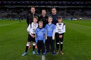 27 January 2016; Match referee Padraig Hughes, with the two captains Conor McManus and Stephen Cluxton with Allianz mascots Mark Butler, second from left, and his brother Christopher, from Bayside N.S., and 'Young Whistelers' Rory Perry, extreme left, Scoil Mológa, Harold's Cross and Harry Collier, right, St Helen's Portmarnock, before the game. Allianz Football League, Division 1, Round 3, Dublin v Monaghan. Croke Park, Dublin. Picture credit: Ray McManus / SPORTSFILE