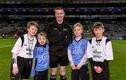 27 January 2016; Match referee Padraig Hughes with Allianz mascots Mark Butler, second from left, and his brother Christopher, from Bayside N.S., and 'Young Whistelers' Rory Perry, extreme left, Scoil Mológa, Harold's Cross and Harry Collier, right, St Helen's Portmarnock, before the game. Allianz Football League, Division 1, Round 3, Dublin v Monaghan. Croke Park, Dublin. Picture credit: Ray McManus / SPORTSFILE
