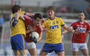 28 February 2016; Jamie O'Sullivan, Cork, in action against Conor Devaney, left, and Cathal McHugh, Roscommon. Allianz Football League, Division 1, Round 3, Cork v Roscommon. Páirc Uí Rinn, Cork. Picture credit: Diarmuid Greene / SPORTSFILE