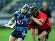 6 April 2001; Paul Doheny of UCD is tackled by Rory O'Doherty of UCC during the Fitzgibbon Cup Final match between UCD and UCC at Parnell Park in Dublin. Photo by Damien Eagers/Sportsfile