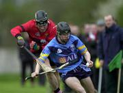 18 April 2001; Brendan Murphy of UCD in action against John Browne of UCC the Fitzgibbon Cup Final Replay match between UCD and UCC at McDonagh Park in Nenagh, Tipperary. Photo by Ray McManus/Sportsfile