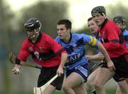 18 April 2001; Colin Morrisey of UCC in action against Hugh Gannon of UCD during the Fitzgibbon Cup Final Replay match between UCD and UCC at McDonagh Park in Nenagh, Tipperary. Photo by Ray McManus/Sportsfile