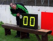 15 April 2001; Fourth official Larry Doyle prepares the clock which displays the amount of added time for each half before the Leinster Senior Hurling Championship First Preliminary Round match between Carlow and Westmeath at Dr Cullen Park in Carlow. Photo by Aoife Rice/Sportsfile