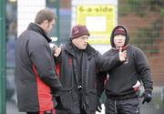 12 January 2010; Ulster Head Coach, Brian McLaughlin, centre, along with Jeremy Davidson, assistant forward coach, left, and Neil Doak assistant backs coach, in action during squad training ahead of their Heineken Cup game against Edinburgh on Friday night. Ashfield Boys School, Belfast, Co. Antrim. Picture credit: Oliver McVeigh / SPORTSFILE