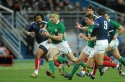 13 February 2010; Jamie Heaslip and Ronan O'Gara, Ireland, in action against Mathieu Bastareaud, left, and Morgan Parra, France. RBS Six Nations Rugby Championship, France v Ireland, Stade de France, Saint Denis, Paris, France. Picture credit: Brian Lawless / SPORTSFILE