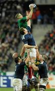 13 February 2010; Jamie Heaslip, Ireland, takes the ball in a lineout ahead of Pascal Pape, France. RBS Six Nations Rugby Championship, France v Ireland, Stade de France, Saint Denis, Paris, France. Picture credit: Brian Lawless / SPORTSFILE